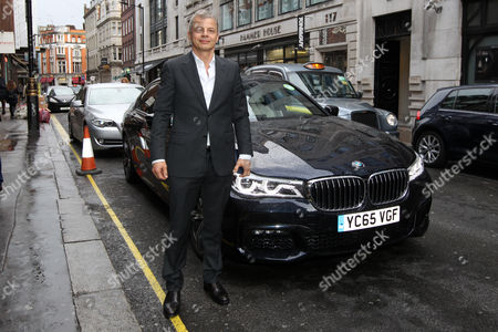 Stock Image of Rainer Becker arrives in the luxury BMW 7 Series at the GQ Food and Drink Awards