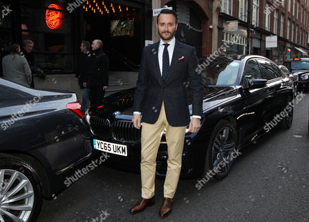 Stock Photo of Jason Atherton, newly named best restaurateur arrives in the luxury BMW 7 Series at the GQ Food and Drink Awards