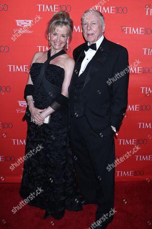 T. Boone Pickens, Oil billionaire (R) and guest (L)