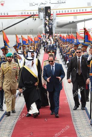 Egyptian President Abdel Fattah al-Sisi welcomes Bahrain's King King Hamad bin Isa Al Khalifa upon his arrival at Cairo's international airport