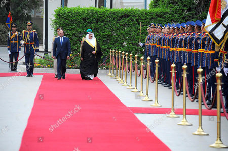 Egyptian President Abdel Fattah al-Sisi and Bahrain's King Hamad bin Isa Al Khalifa reviewing the honor guard during a welcoming ceremony in the capital Cairo