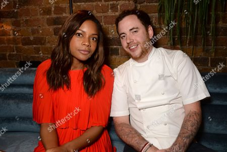 Stock Photo of Naomie Harris and Tom Sellers