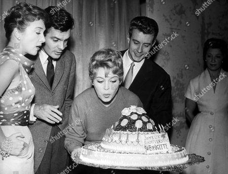 'The Bride is Much Too Beautiful' aka 'La Mariee est Trop Belle' - Micheline Presle, Louis Jourdan, Brigitte Bardot, Marcel Amont celebrate Brigitte's 22nd birthday on set - 1956