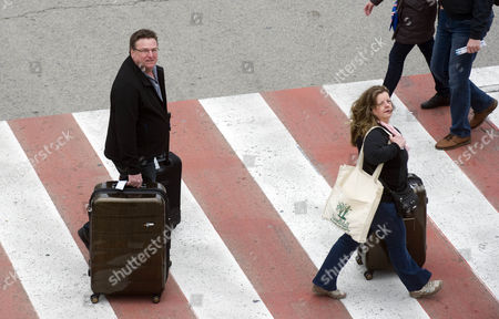 Passengers Mark Stevens And Wife Annette From Alberta Canada Disembark The Msc Splendida After It Docked At The Port Of Barcelona Spain. Some Of Its Passengers Were Attacked And Murdered By Islamic Fanatics While On An Excursion To A Museum In Tunis Tunisa 20.03.15.