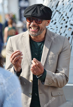 Stock Image of 9/4/15 Day1 - Grand National Meeting At Aintree Racecourse Merseyside.- Lead Singer In Band 'the Christians' Garry Christian.