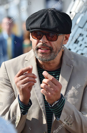 Stock Picture of 9/4/15 Day1 - Grand National Meeting At Aintree Racecourse Merseyside.- Lead Singer In Band 'the Christians' Garry Christian.