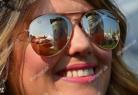9/4/15 Day1 - Grand National Meeting At Aintree Racecourse Merseyside.- Hot Weather Pix - Grand National Sign Reflected In Sunglasses Of Race Goer Sarah Evans From Liverpool.