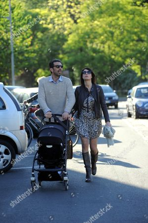 Stock Photo of Gianluigi Buffon and Ilaria D'Amico with their son Leopoldo Mattia