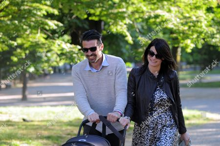 Stock Picture of Gianluigi Buffon and Ilaria D'Amico with their son Leopoldo Mattia