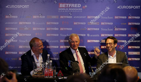 (Left to right) Eurosport CEO Peter Hutton, Chairman of the World Professional Billiards and Snooker Association Barry Hearn and Adam Kelly of IMG during a press conference announcing a new 10 year broadcast deal with Eurosport for coverage of snooker during day 13 of the Betfred World Snooker Championship