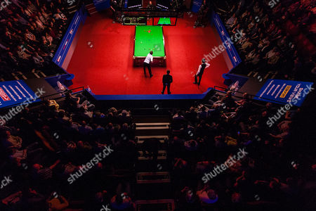 Alan McManus (left) and Ding Junhui during the semi final on day 13 of the Betfred World Snooker Championship