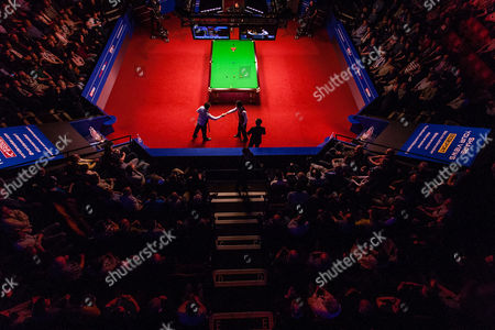 Alan McManus shakes hands with Ding Junhui at the start of the semi final on day 13 of the Betfred World Snooker Championship