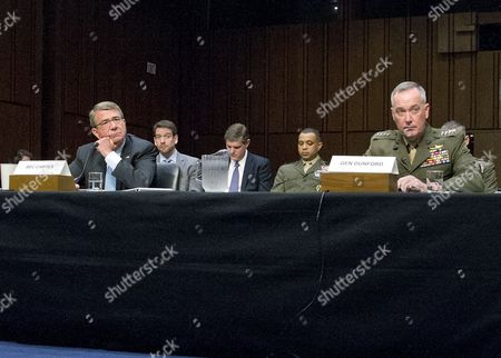 Stock Photo of Secretary Of Defense Ashton B. Carter and General Joseph F. Dunford, Jr., USMC, Chairman of The Joint Chiefs of Staff, right, give testimony before the committee