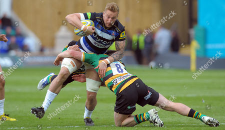 Bath's Dominic Day brought down in simultaneous tackles - Rugby Union - Aviva Premiership - Round 21 - Northampton Saints v Bath Rugby - 30/04/16 - At Franklin's Gardens, Northampton UK. Photo Credit - Tom Dwyer/Seconds Left Images