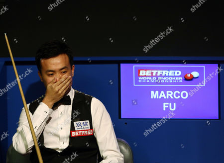 Marco Fu looks thoughtful during the semi final on day 15 of the Betfred World Snooker Championship 2016 at the Crucible Theatre, Sheffield on 29th April 2016