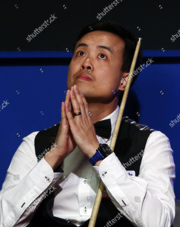 Marco Fu gestures to pray during the semi final on day 15 of the Betfred World Snooker Championship 2016 at the Crucible Theatre, Sheffield on 29th April 2016
