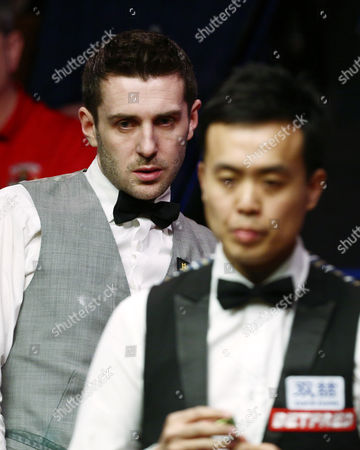 Mark Selby looks on behind Marco Fu during the semi final on day 15 of the Betfred World Snooker Championship 2016 at the Crucible Theatre, Sheffield on 29th April 2016