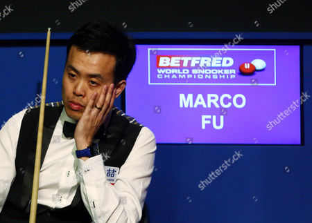 Marco Fu looks on playing in a frame lasting over one hour during the semi final on day 15 of the Betfred World Snooker Championship 2016 at the Crucible Theatre, Sheffield on 29th April 2016