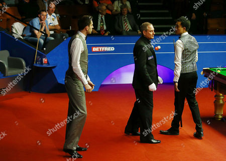 Stock Picture of Mark Selby and Marco Fu request a break during a frame lasting over one hour during the semi final on day 15 of the Betfred World Snooker Championship 2016 at the Crucible Theatre, Sheffield on 29th April 2016