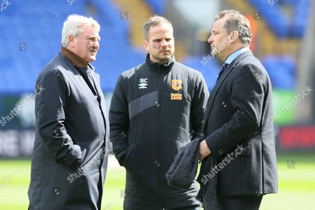 Hull City manager Steve Bruce and /CEO Dean Holdsworth chat before the Sky Bet Championship match between Bolton Wanderers and Hull City played at the Macron Stadium, Bolton on April 30th 2016