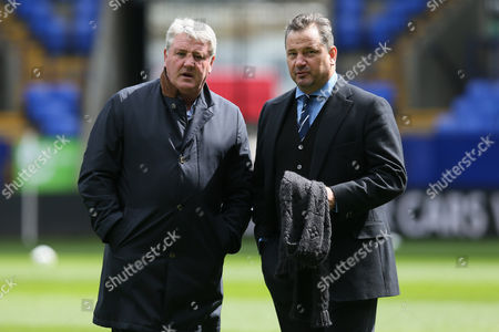 Hull City manager Steve Bruce and CEO Dean Holdsworth chat before the Sky Bet Championship match between Bolton Wanderers and Hull City played at the Macron Stadium, Bolton on April 30th 2016