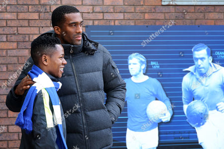 Sylvain Distin poses for a photograph with an Everton fan ahead of the Barclays Premier League match between Everton and AFC Bournemouth at Goodison Park, Liverpool on 30th April 2016
