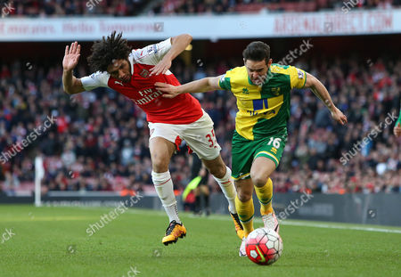 Matt Jarvis of Norwich in action with Mohamed Elneny of Arsenal