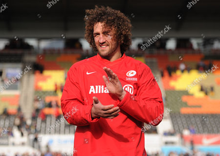 Jacques Burger of Saracens applauds the fans during a lap of honour during the Aviva Premiership Rugby match between Saracens and Newcastle Falcons played at Allianz Park, London on May 1st 2016