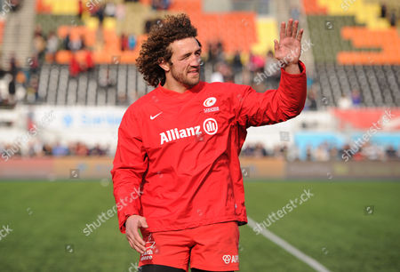 Jacques Burger of Saracens waves to fans as he takes a lap of honour during the Aviva Premiership Rugby match between Saracens and Newcastle Falcons played at Allianz Park, London on May 1st 2016