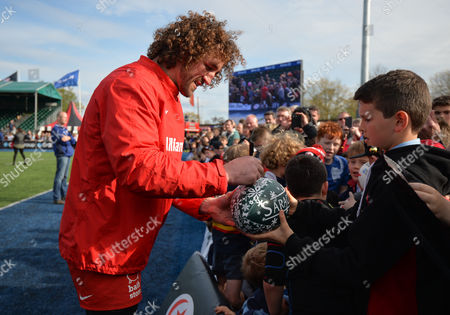 Jacques Burger of Saracens signs autographs for fans during the Aviva Premiership Rugby match between Saracens and Newcastle Falcons played at Allianz Park, London on May 1st 2016