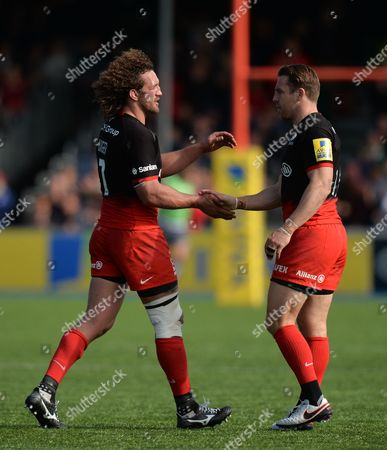 Jacques Burger shakes hands with Chris Wyles of Saracens as he leaves the field during the Aviva Premiership Rugby match between Saracens and Newcastle Falcons played at Allianz Park, London on May 1st 2016