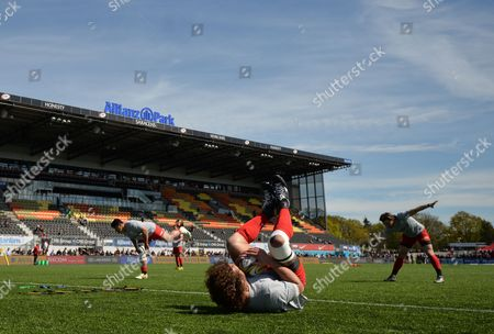 Stock Photo of Jacques Burger of Saracens (foreground) warms-up during the Aviva Premiership Rugby match between Saracens and Newcastle Falcons played at Allianz Park, London on May 1st 2016