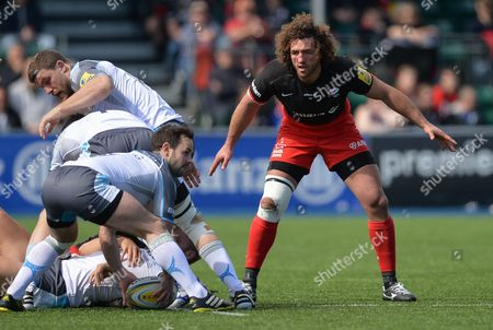 Jacques Burger of Saracens looks on as Micky Young of Newcastle Falcons attempts to clear the ball during the Aviva Premiership Rugby match between Saracens and Newcastle Falcons played at Allianz Park, London on May 1st 2016