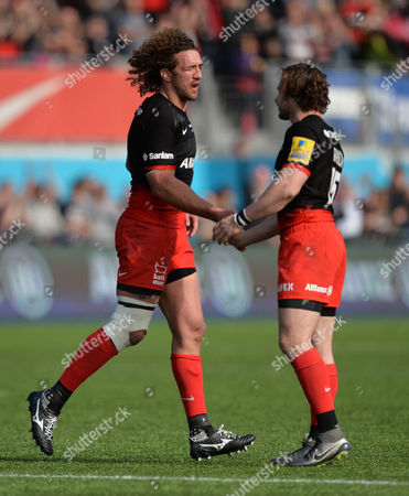 Jacques Burger shakes hands with Ben Ransom of Saracens as he leaves the game during the Aviva Premiership Rugby match between Saracens and Newcastle Falcons played at Allianz Park, London on May 1st 2016