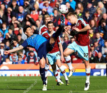 Alejandro Faurlin of Queens Park Rangers challenges Burnley's Scott Arfield