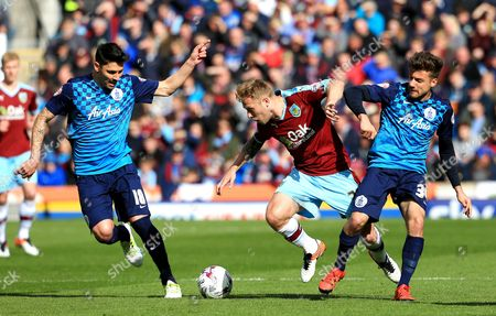 Burnley's Scott Arfield is tackled by Alejandro Faurlin of Queens Park Rangers