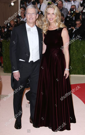 Tim Cook and Laurene Powell Jobs