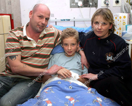 Daniel Carr in Ipswich hospital with parents Nigel Carr and Sharon O' Donnell.