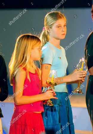 Tilly Smith (right with sister Holly) was credited with saving her family and over 100 fellow tourists in the boxing day 2004 tsunami. She read a poem in front of Crown Princess Ubol Ratana at an Interfaith Memorial Service at Bang Niang Beach, Phang nga