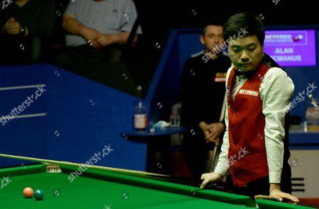 Stock Image of Alan McManus and Ding Junhui