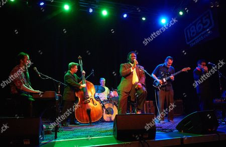 Stock Picture of Mud Morganfield and his band