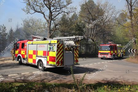 Huge flames, fanned by winds, spread across woodland owned by the Newbury MP Richard Benyon.