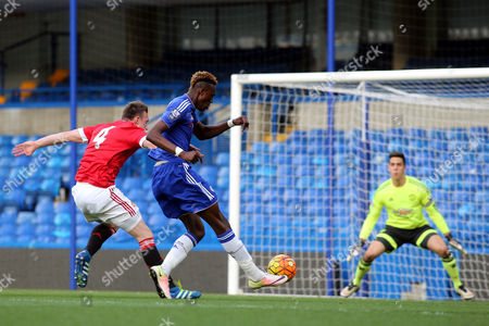 Chelsea's Tammy Abraham manages to get a shot at the Manchester United goal in spite of the close marking of Phil Jones of Manchester United during Chelsea Under-21 vs Manchester United Under-21, Barclays U21 Premier League Football at Stamford Bridge on 6th May 2016