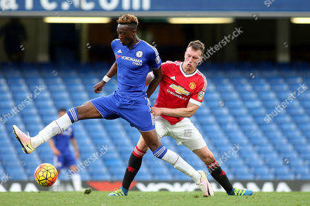 Tammy Abraham of Chelsea controls the ball under pressure from Manchester United's Phil Jones during Chelsea Under-21 vs Manchester United Under-21, Barclays U21 Premier League Football at Stamford Bridge on 6th May 2016