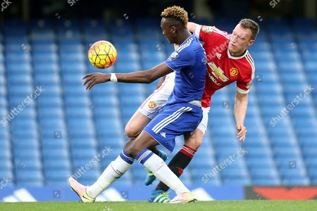 Tammy Abraham of Chelsea and Manchester United's Phil Jones challenge for the ball during Chelsea Under-21 vs Manchester United Under-21, Barclays U21 Premier League Football at Stamford Bridge on 6th May 2016