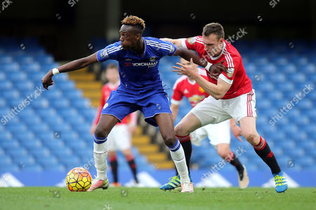 Chelsea's Tammy Abraham shields the ball from Phil Jones of Manchester United during Chelsea Under-21 vs Manchester United Under-21, Barclays U21 Premier League Football at Stamford Bridge on 6th May 2016