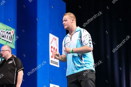 Max Hopp celebrates beating Andy Hamilton in the first round during the 2016 Gibraltar Darts Trophy at the Victoria Stadium
