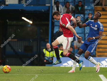 Manchester United's Under 21 Phil Jones holds of Chelsea Under 21s Tammy Abraham during Barclays U21 PremieLeague Chelsea Under 21 v Manchester United Under 21 at Stamford Bridge London 06th May 2016