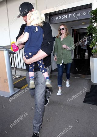 Stock Image of John Krasinski and Emily Blunt with daughter Hazel Krasinski