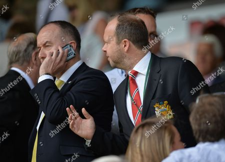 Manchester United Chie Executive Ed Woodward tries to to get the attention of Norwich City Chief Executive David McNally during the Barclays Premier League match between Norwich CIty and Manchester United played at Carrow Road, Norwich on May 7th 2016